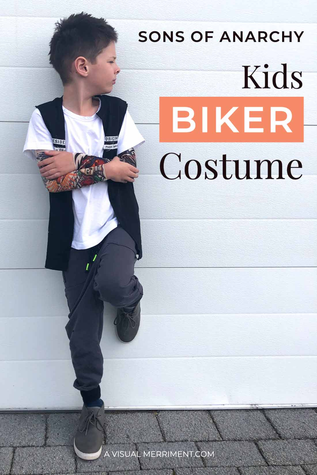 boy standing against wall in biker costume graphic