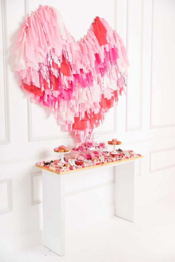 streamer valentines day decoration on wall with food buffet