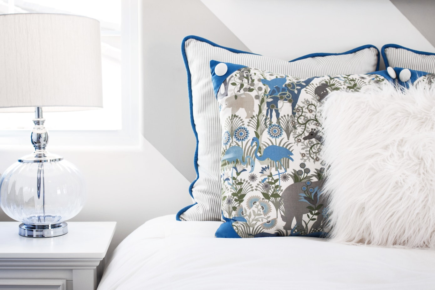 How to style with white bed with blue cushions