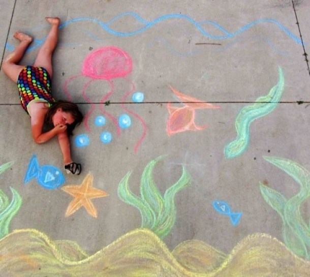 girl in bathers with chalk drawing