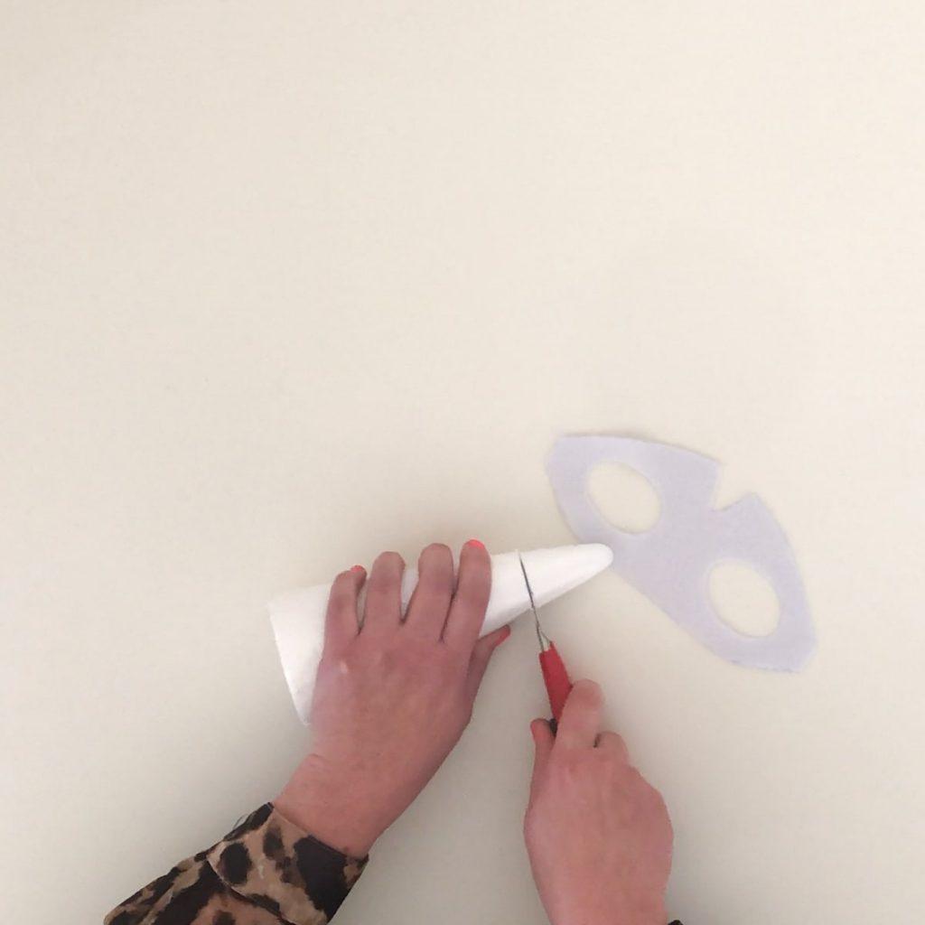 cutting styrofoam cone for unicorn horn