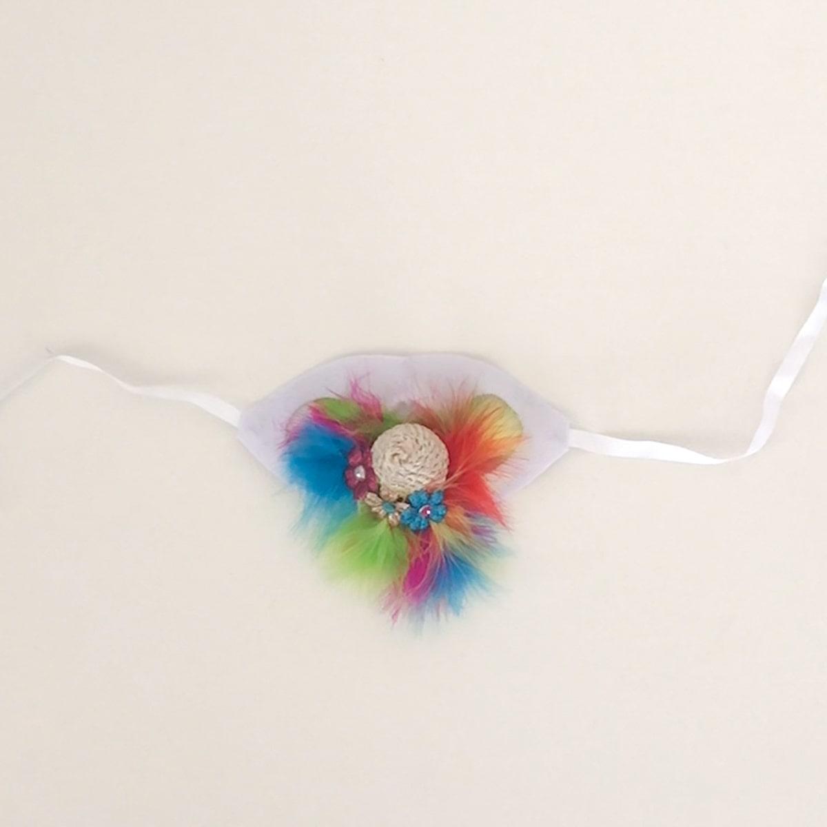 attach flower embellishments to unicorn cat hat
