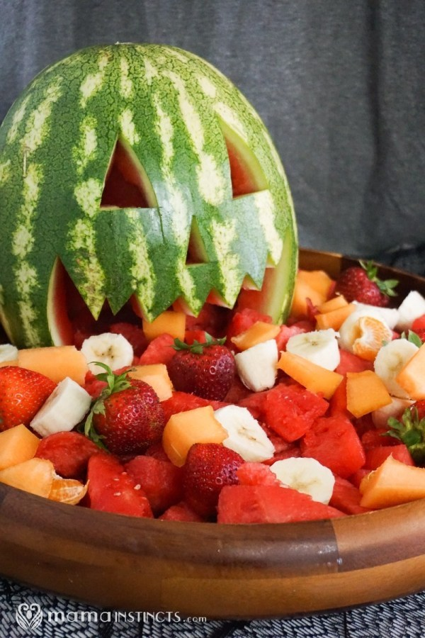 cut watermelon face with fruit on platter