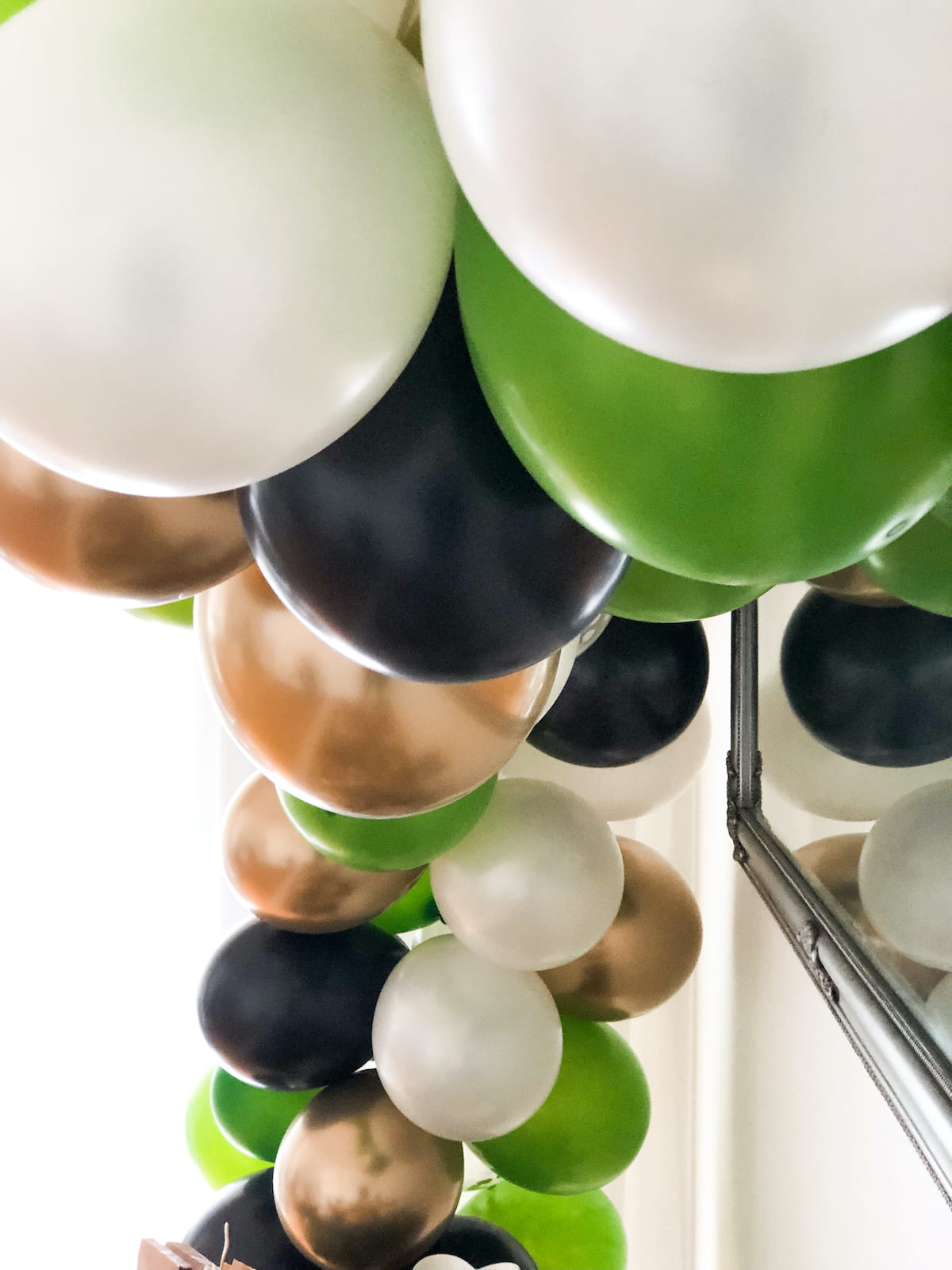 Green and gold balloon arch
