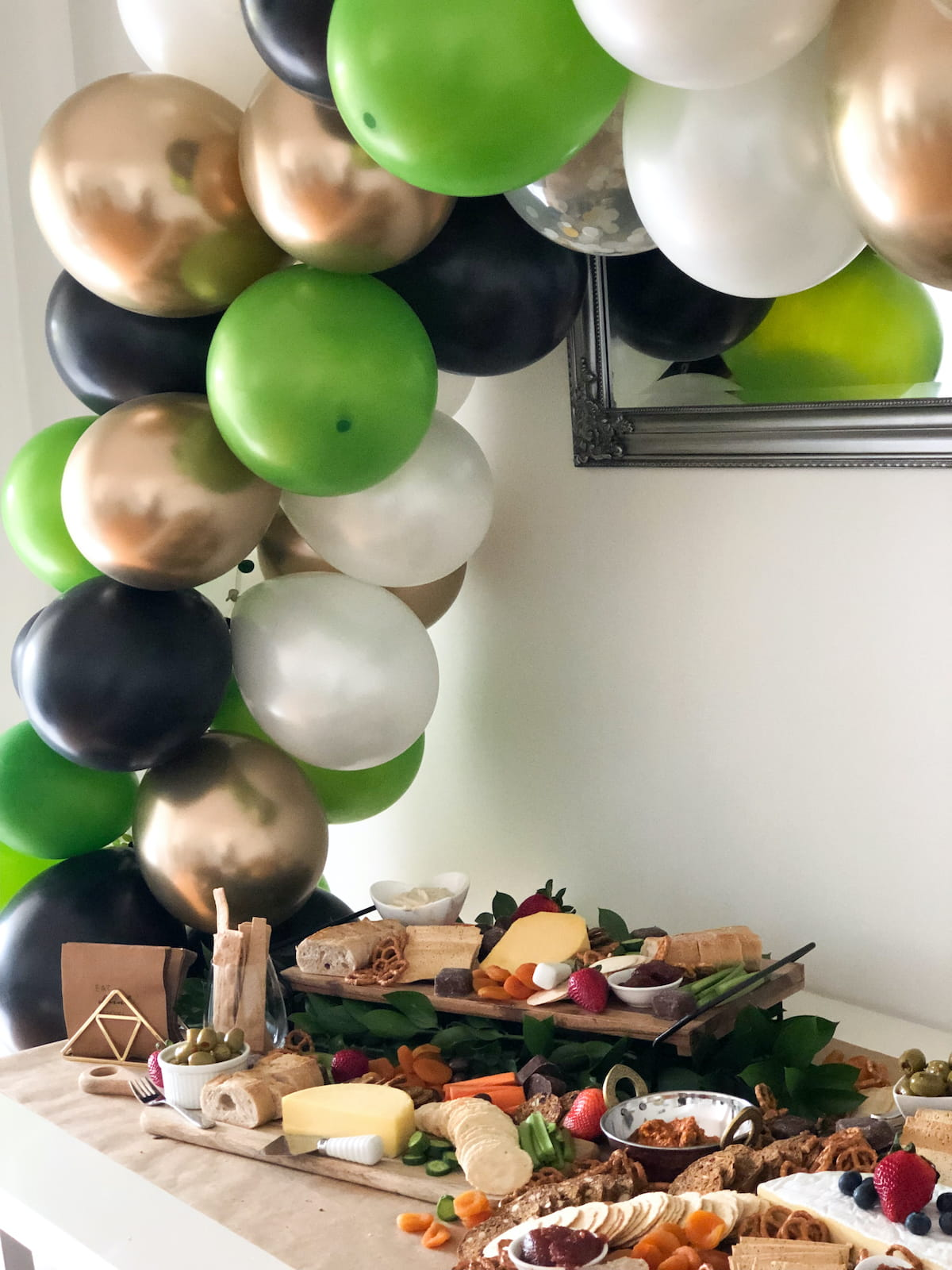 Balloon arch over grazing table