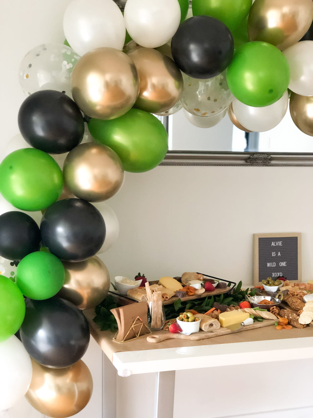 Large balloon arch over grazing table