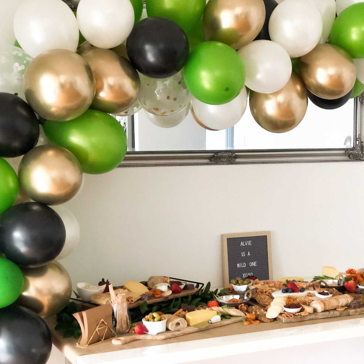Wild one grazing table with balloons