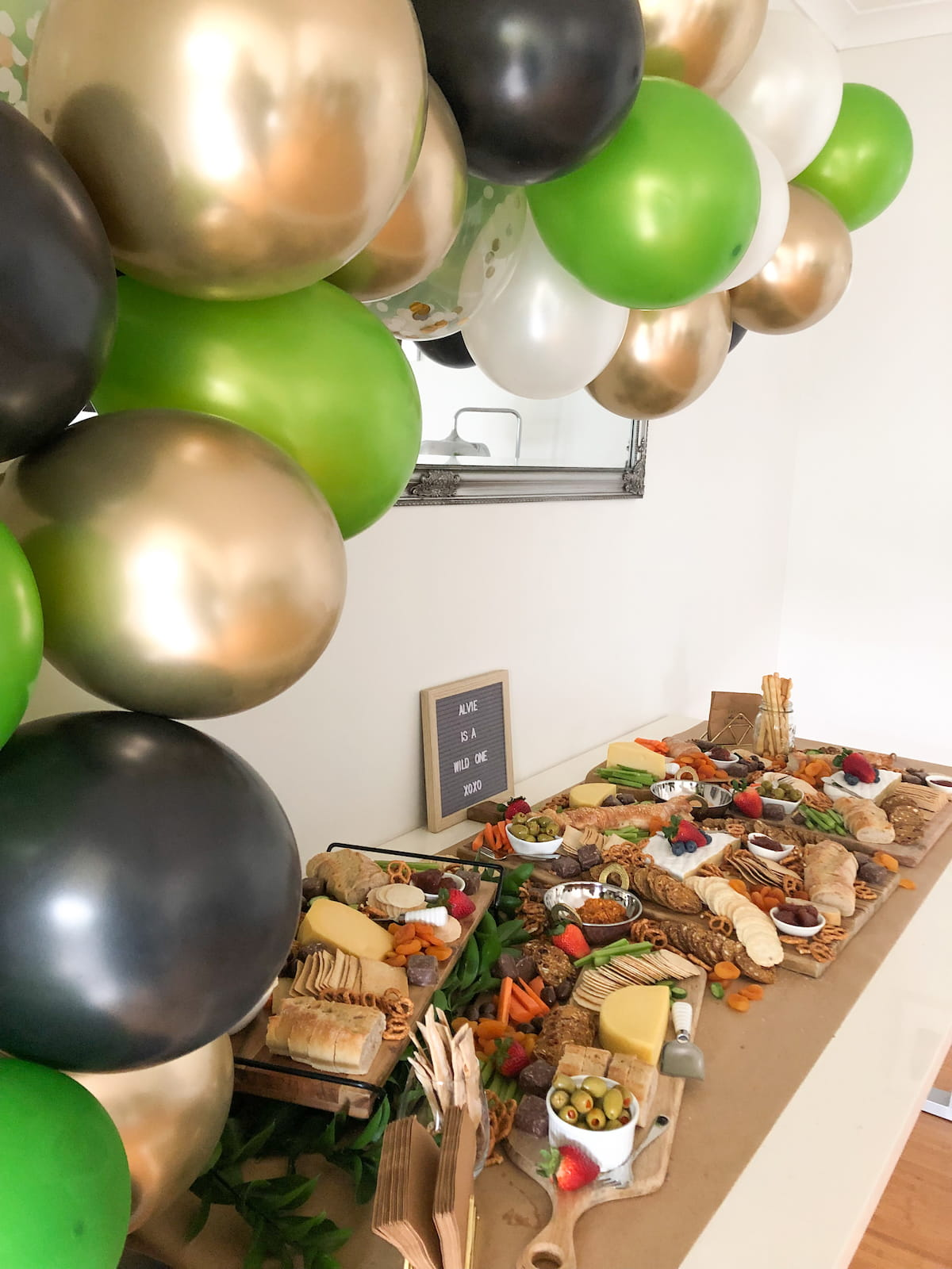 Grazing table buffet with balloon arch