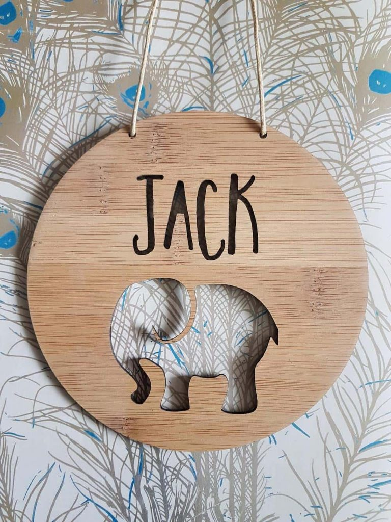 round timber slice with custom name and elephant cutout