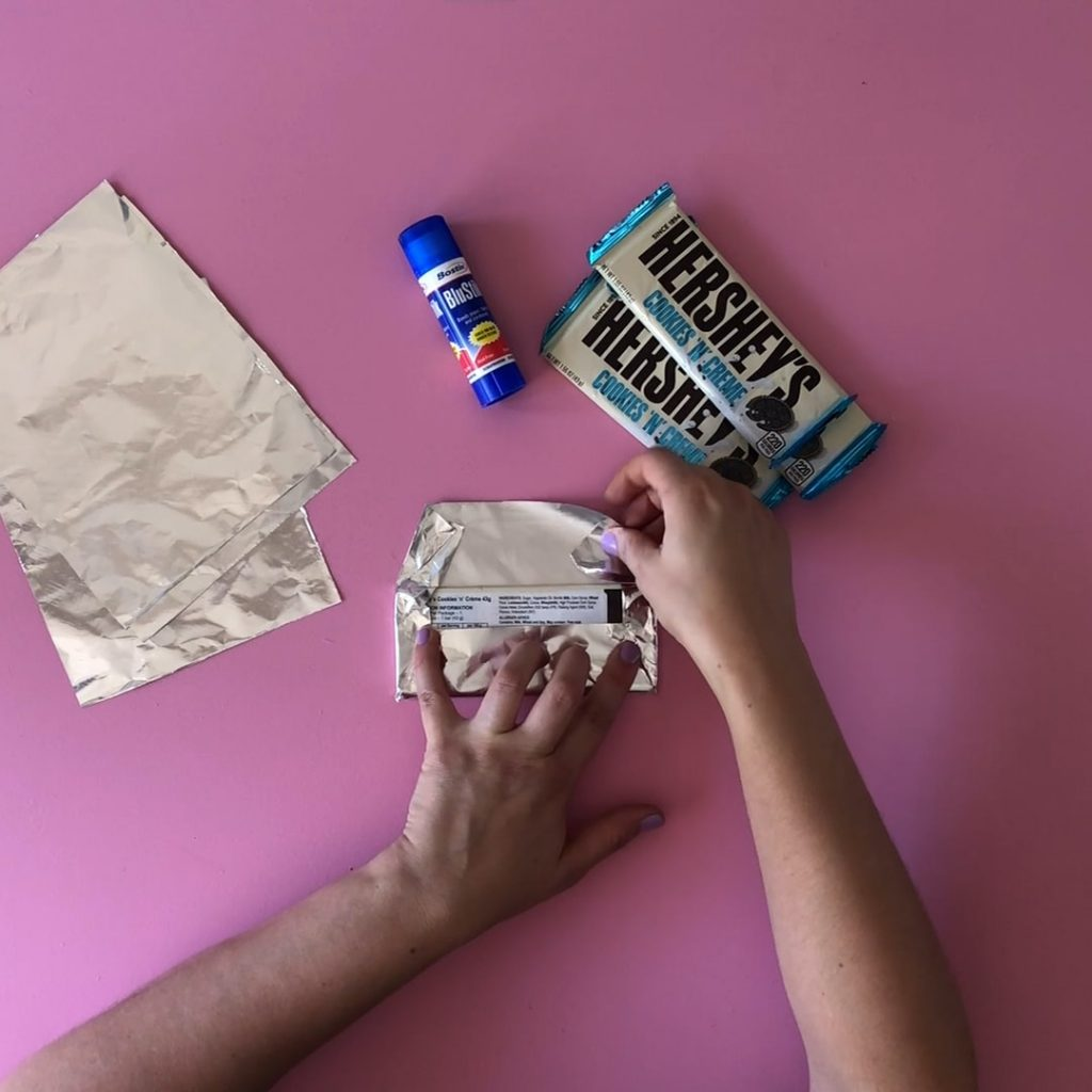 Folding foil wrapper into chocolate bar