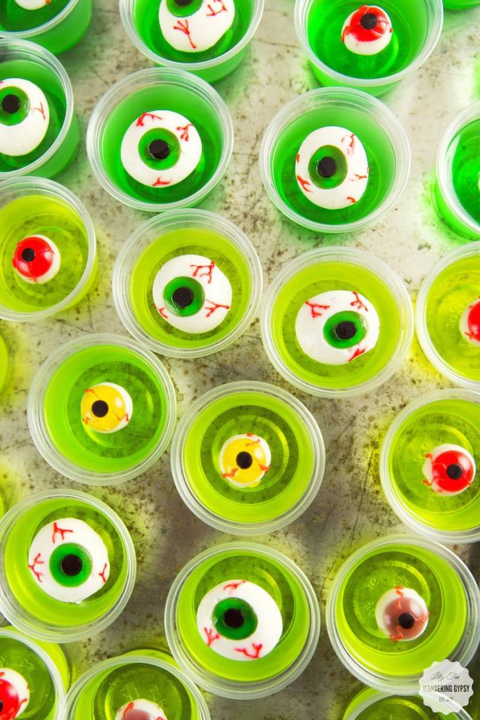 cups of green jello with eyeballs